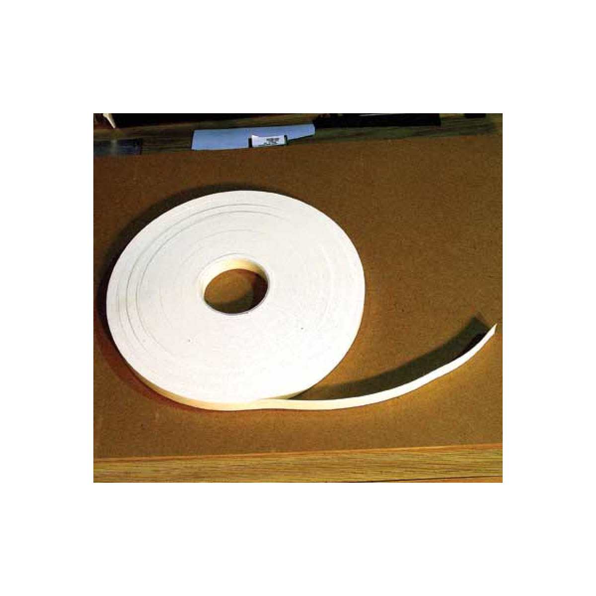 roll of two-sided adhesive foam tape