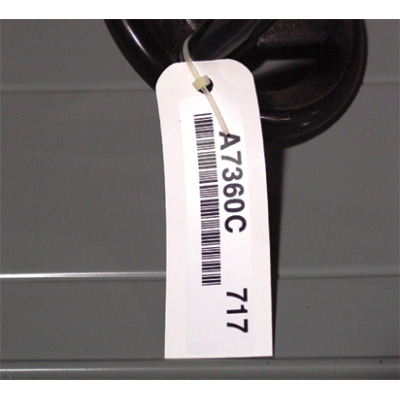 Warehouse label mount tag with a bar code label
